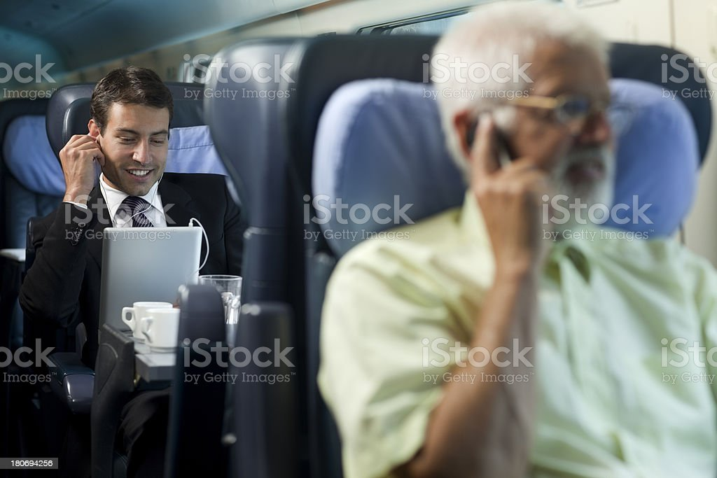 bussinesman seating on a train  beside  window   using digital tablet royalty-free stock photo