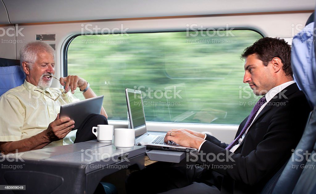 Bussinesman traveling on a train stock photo