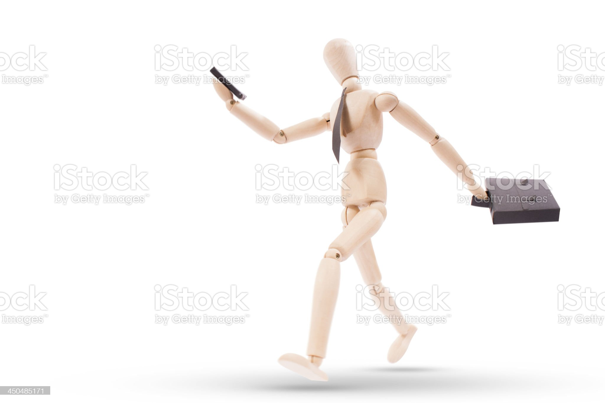 bussiness man running looking to his cellphone with clipping path royalty-free stock photo