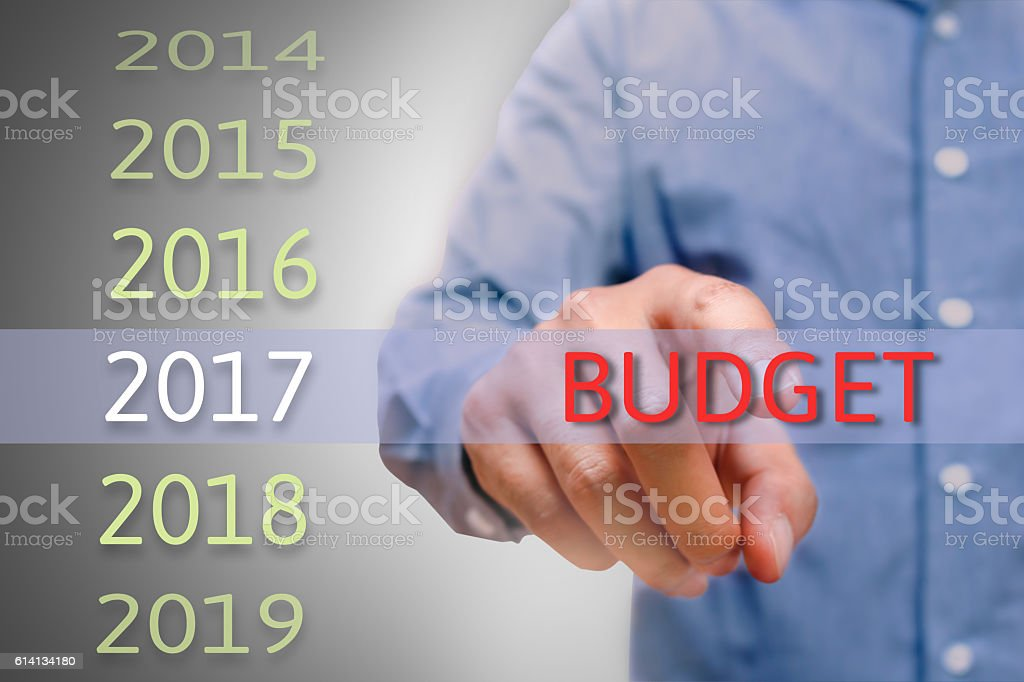 bussinessman hand pointing budget text for 2017. targets concept stock photo