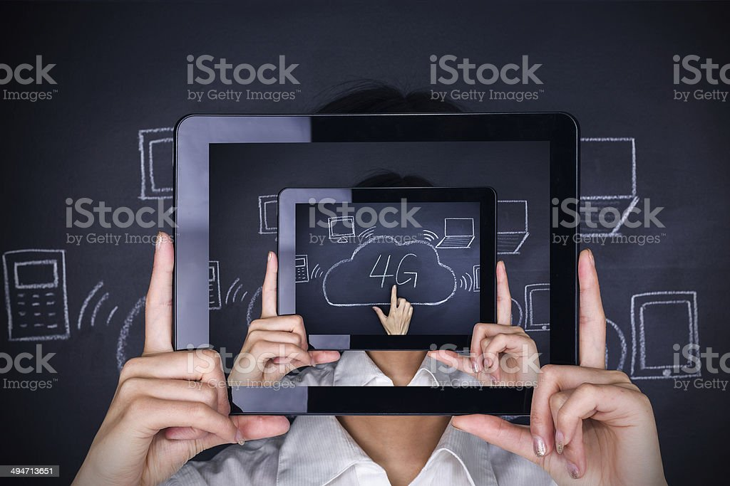 bussinesswoman holding digital tablet with 4G communication sign stock photo