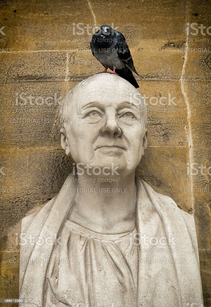 Bust of architect John Nash with pigeon stock photo