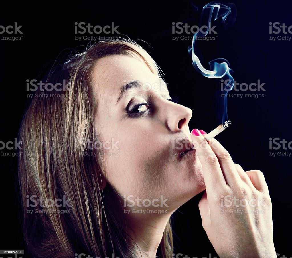 Busted! Beautiful young wman smoking marijuana is caught out. stock photo