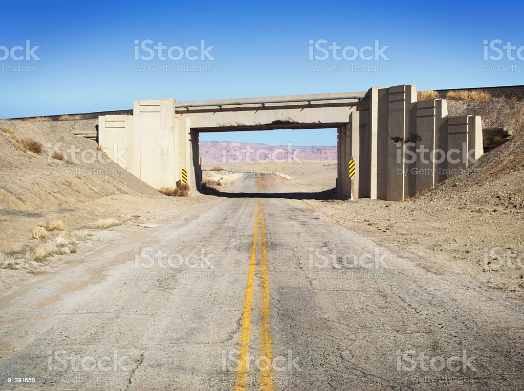 busted up old bridge and desert landscape stock photo