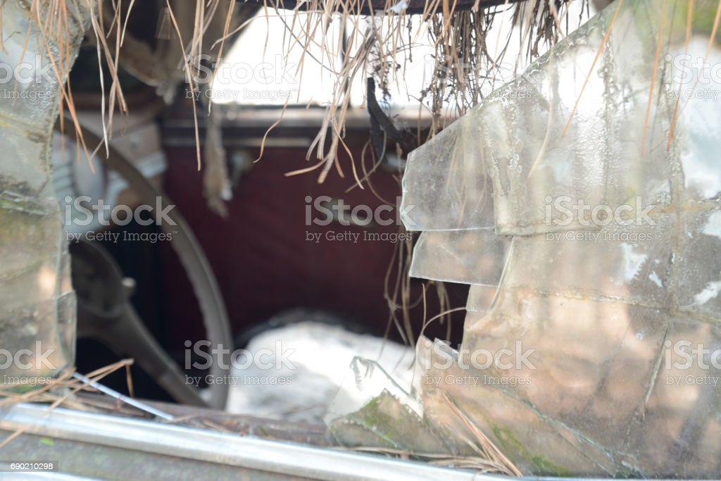 Busted window glass in old antique car. stock photo