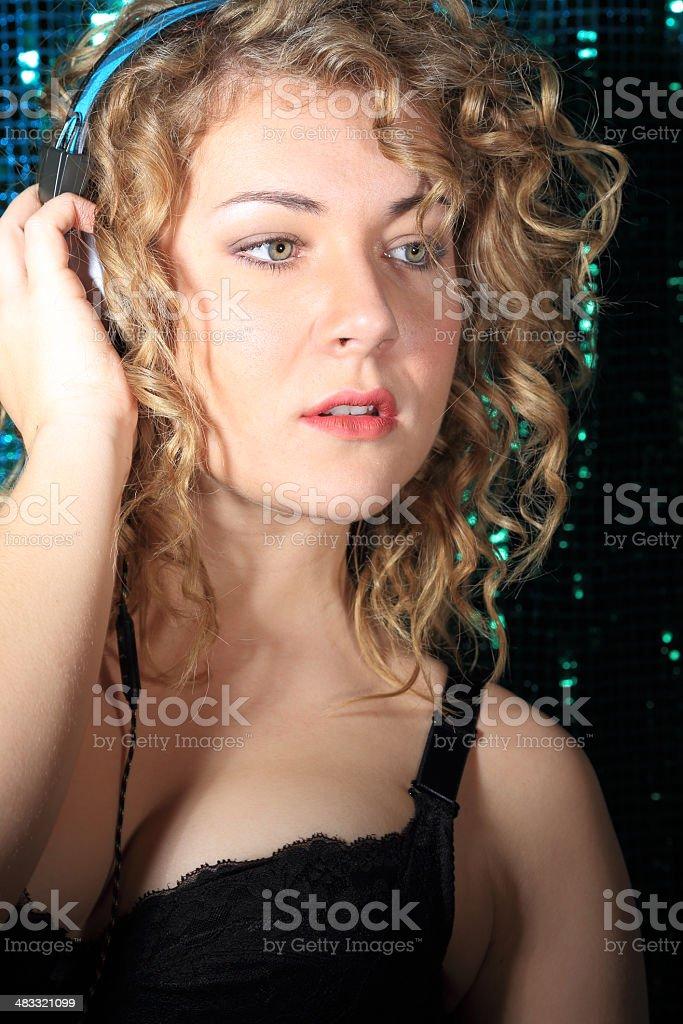 busty female DJ with black bra and headphones stock photo
