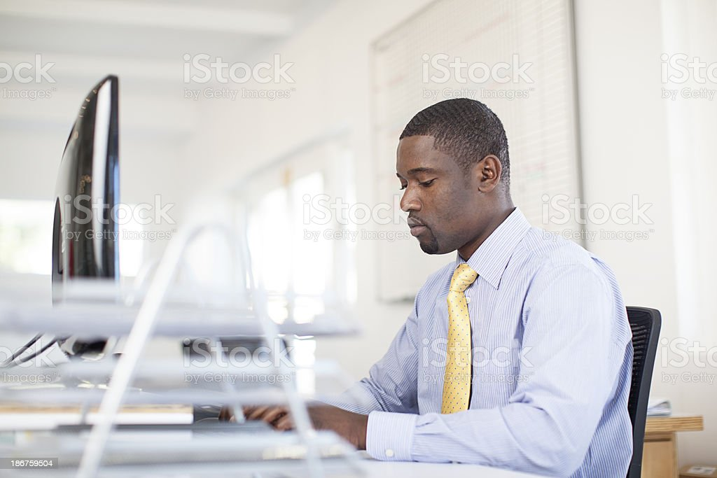 Busy african businessman writing an email. royalty-free stock photo