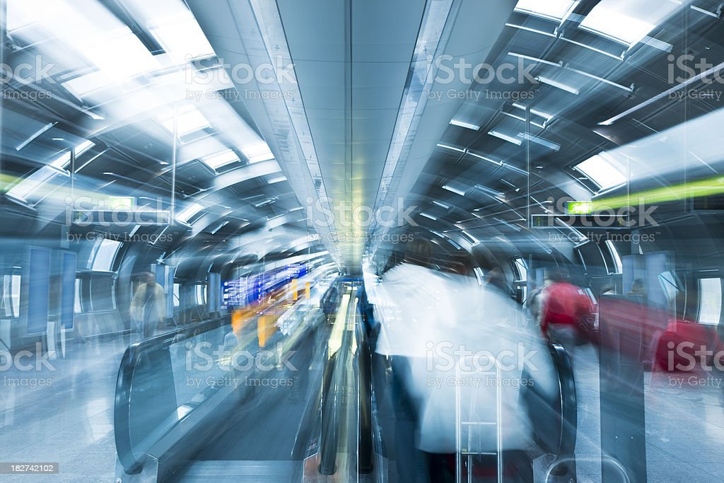 Busy Airport Tunnel with Moving Walkway royalty-free stock photo