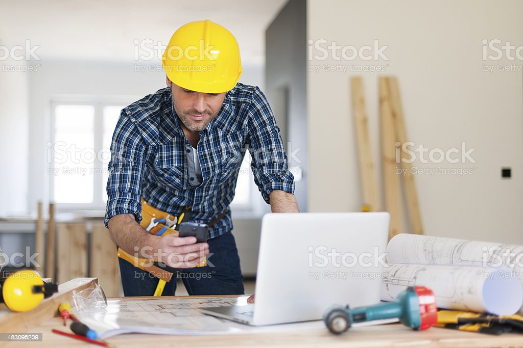 Busy building contractor at work