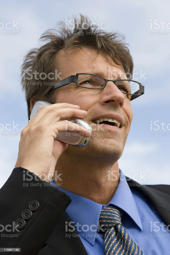 Busy business man on cell phone royalty-free stock photo