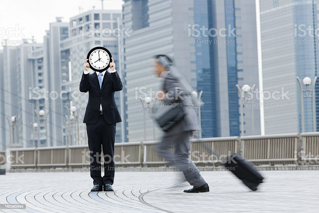 Busy Business Traveler Hurrying, Running Against the Clock Time Deadline royalty-free stock photo