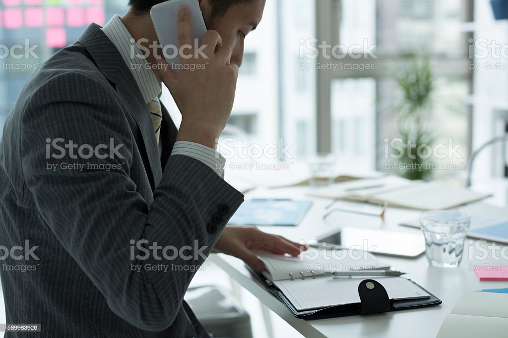 Busy businessman is busy with work. stock photo