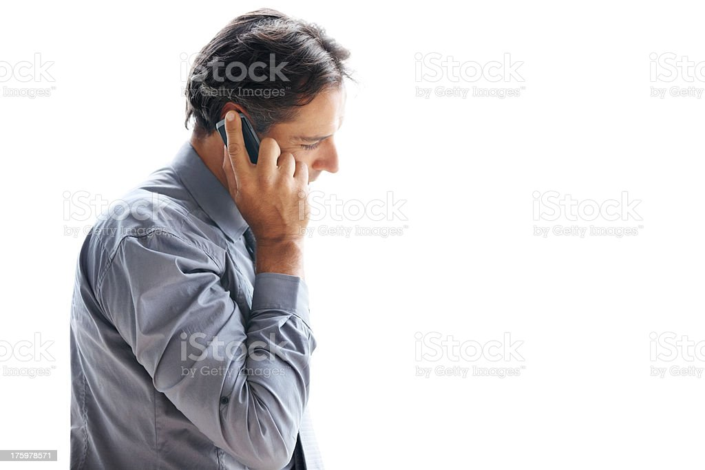 Busy businessman talking on mobile phone - Copyspace stock photo