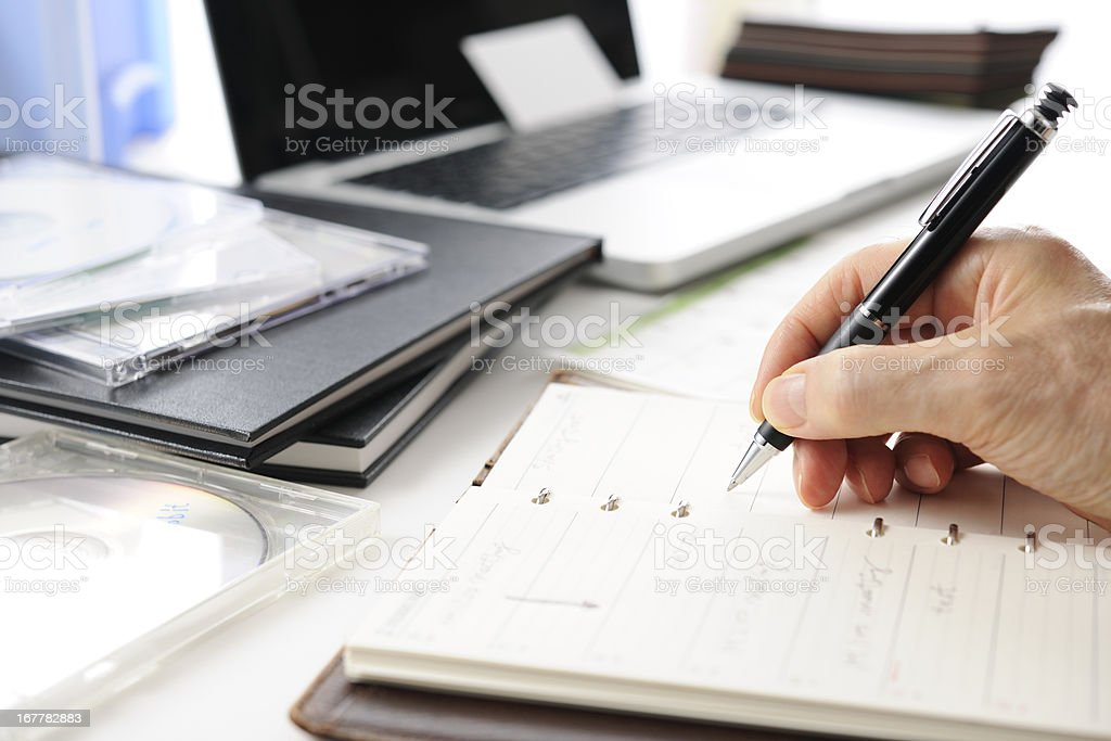 Busy businessman's writing a schedule stock photo