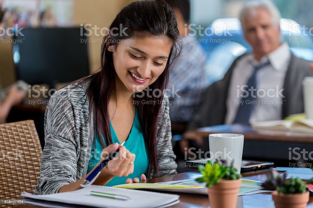 Busy businesswoman at work stock photo