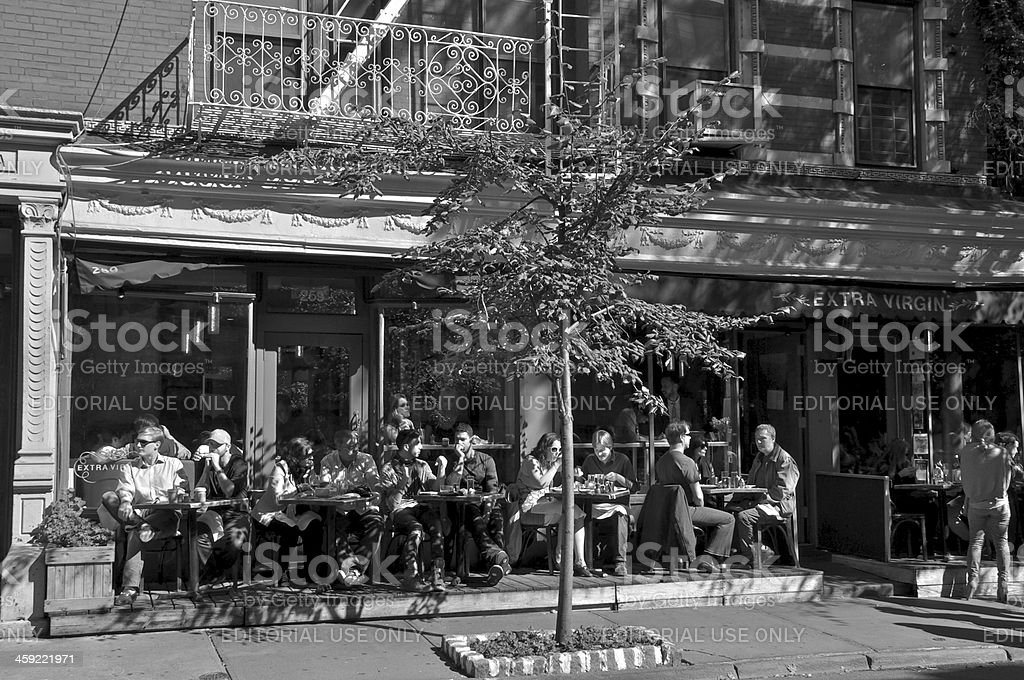 Busy cafe scene in West Greenwich Village, New York City royalty-free stock photo