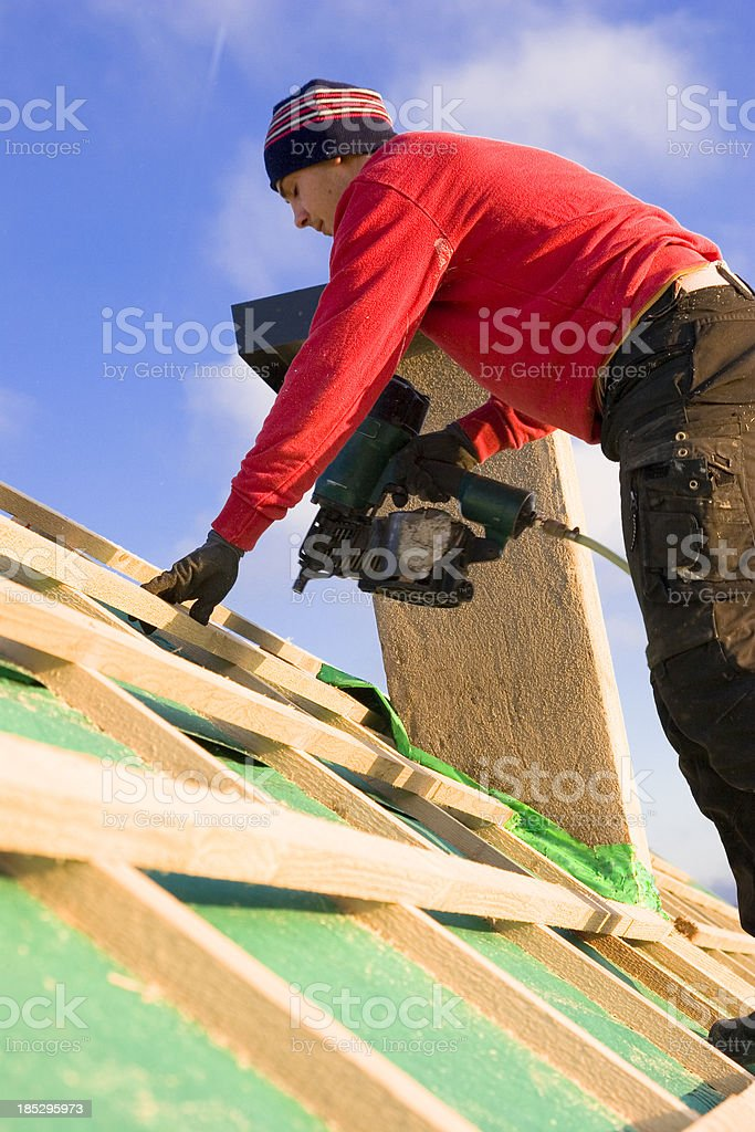 Busy Carpenter on a Roof stock photo