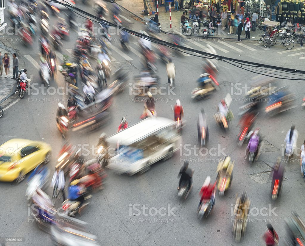 Busy chaotic traffic Hanoi Vietnam Motion blurred stock photo