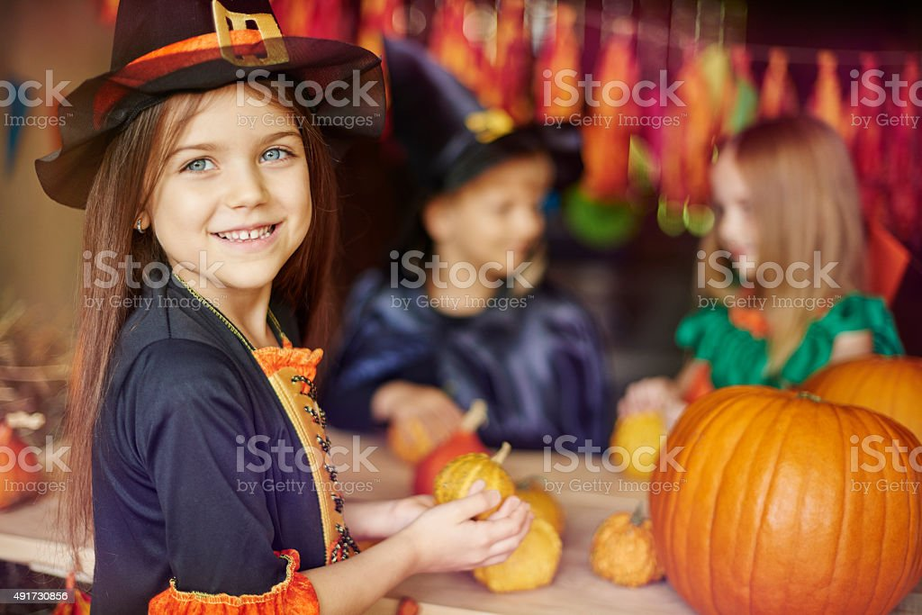Busy children preparing Halloween decorations stock photo