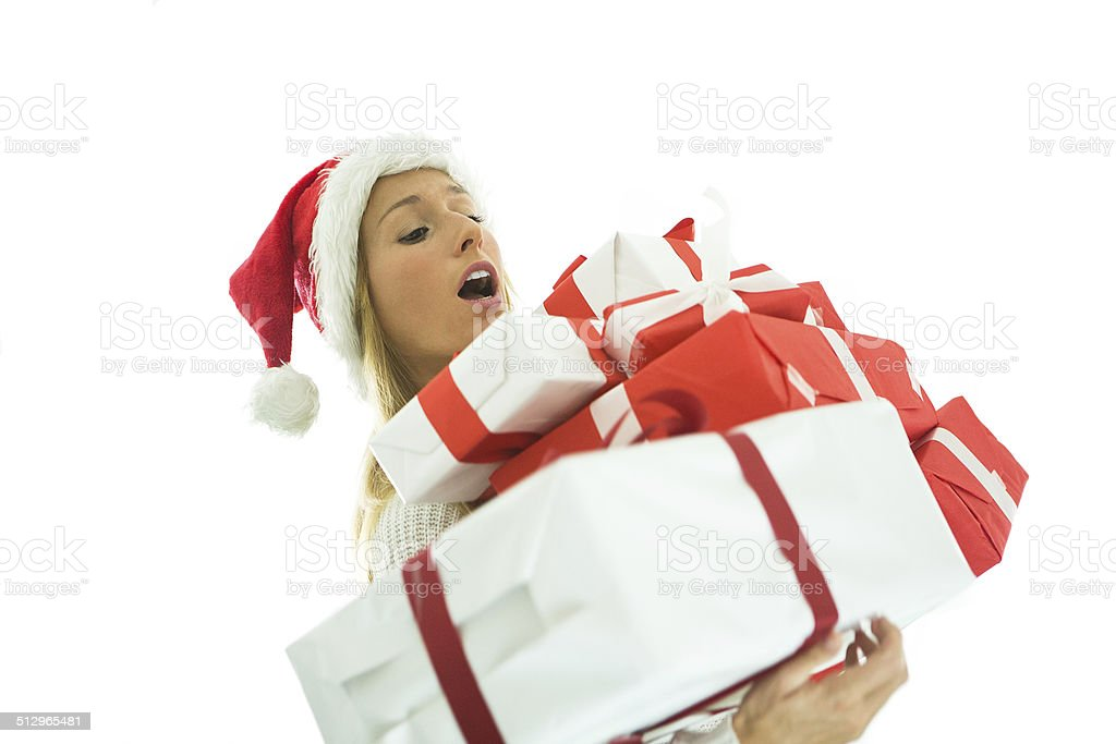 Busy christmas shopping-Woman falling with presents stock photo