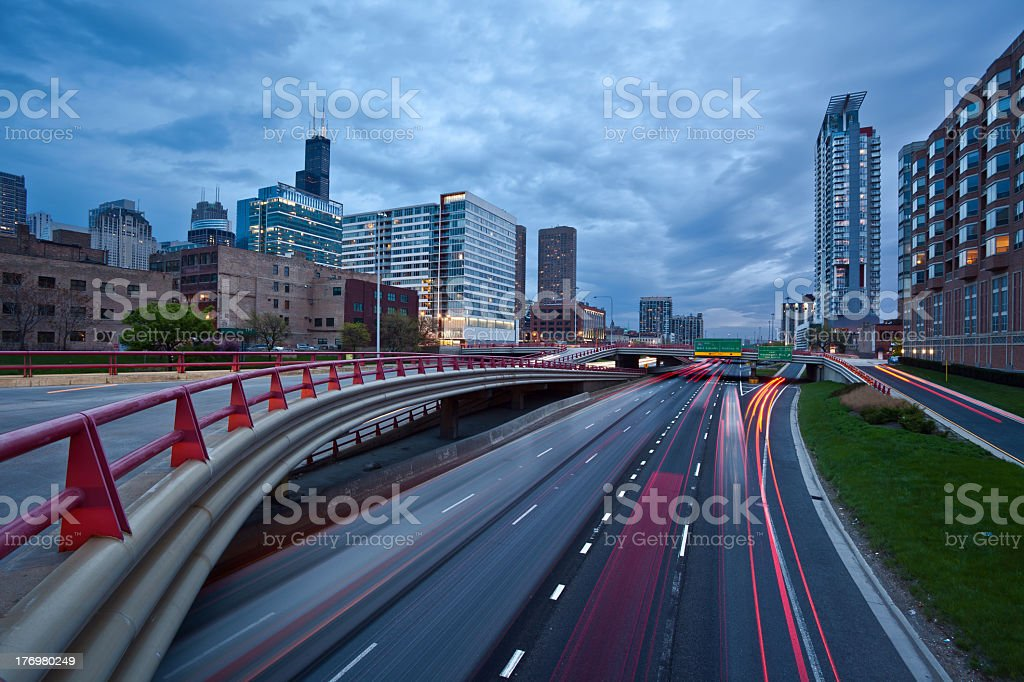 Busy city highway at twilight. stock photo