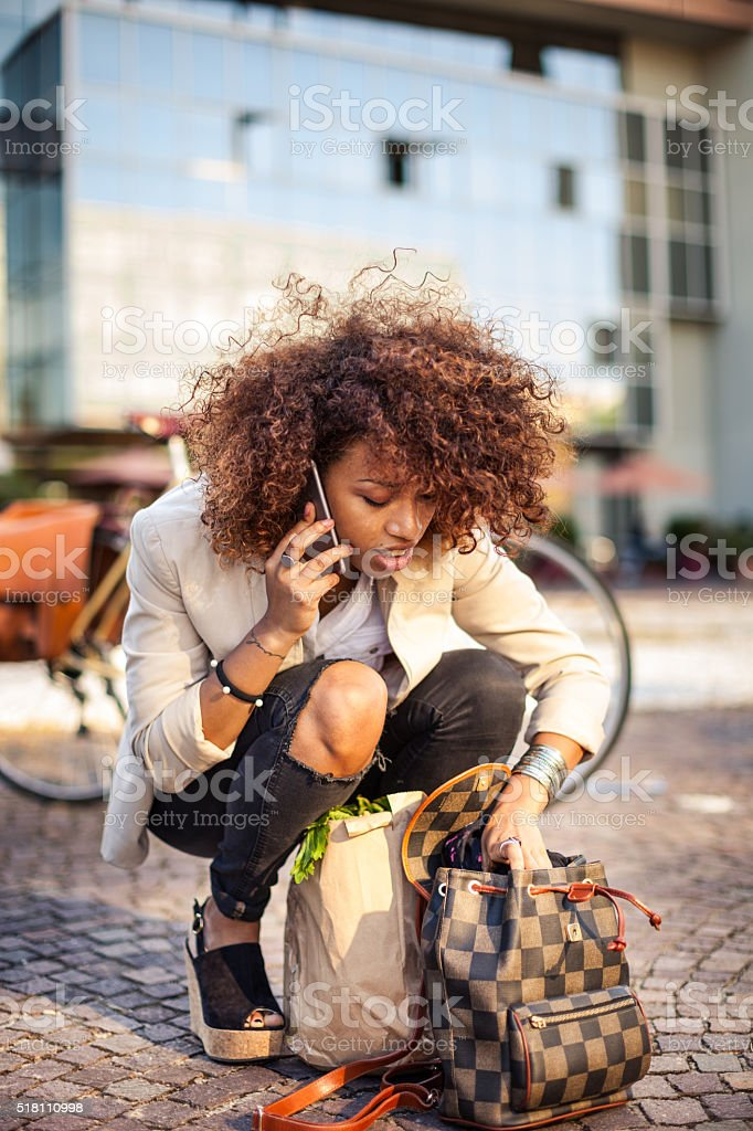 Busy city life. Multitasking modern woman stock photo