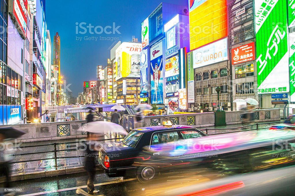 Busy city of Osaka in the rain stock photo