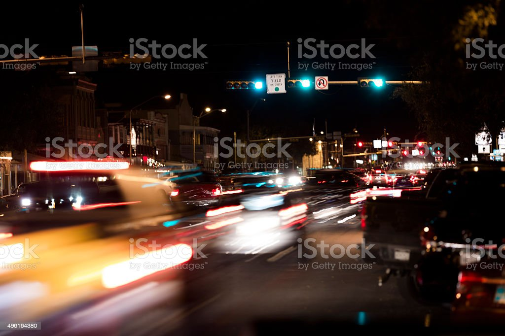 Busy city street. Vehicles, tail lights. Fredericksburg, Texas stock photo