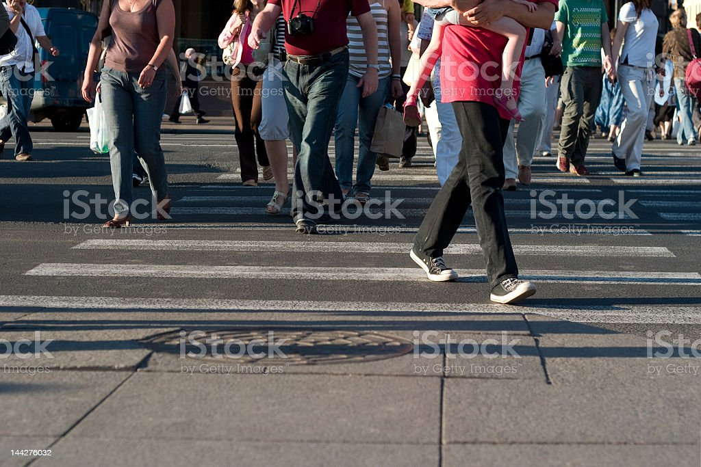A busy city walk filled with people walking royalty-free stock photo