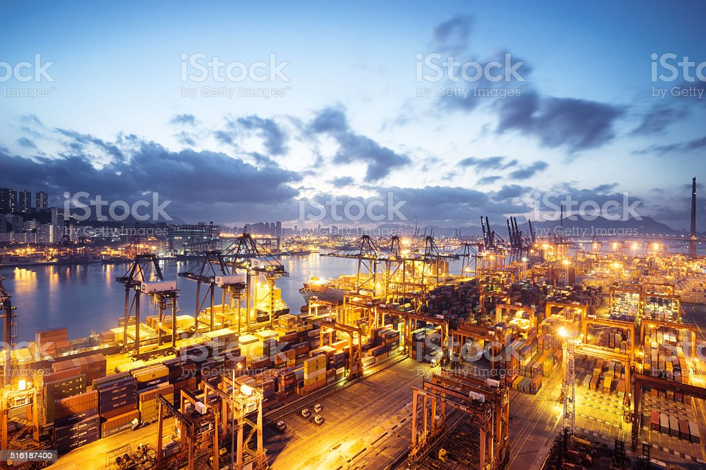 busy container terminal in twilight stock photo