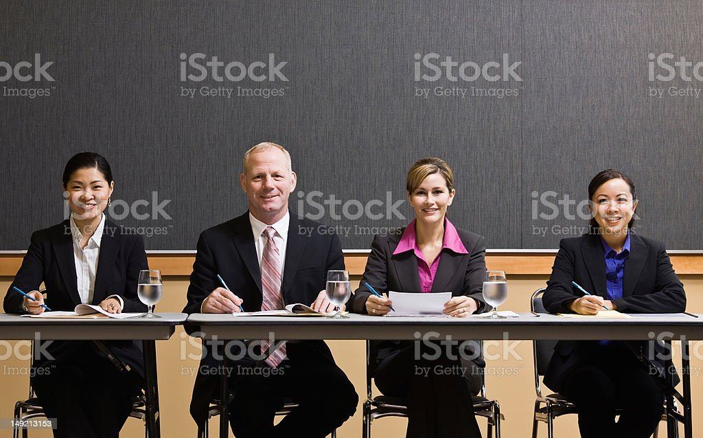 Busy co-workers meeting at table in conference room royalty-free stock photo