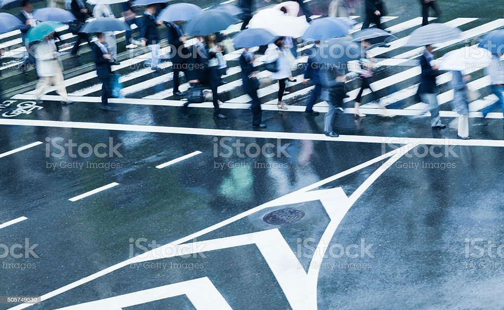 Busy Crosswalk Scene on a Rainy Day with Blur Motion stock photo