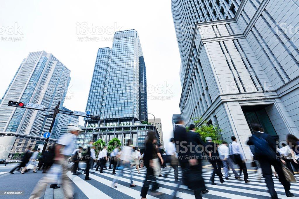 Busy Crosswalk Scene with Blur Motion stock photo