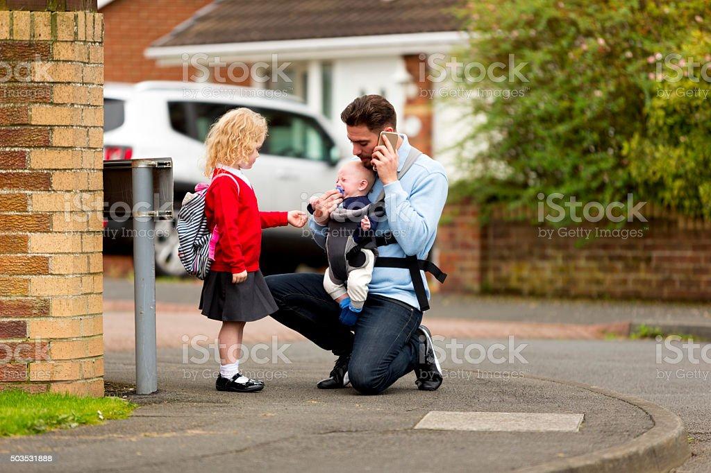 Busy Dad on the school run! stock photo