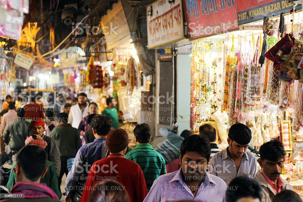 Busy Delhi shopping street at night stock photo