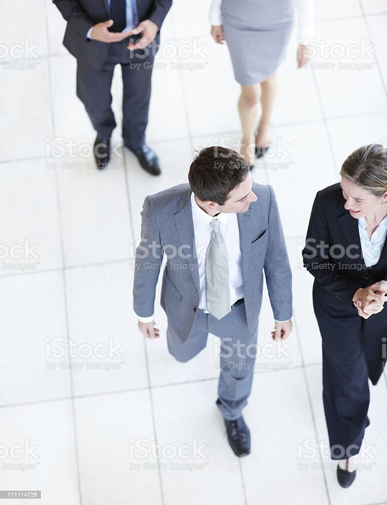 Busy executives on the go royalty-free stock photo
