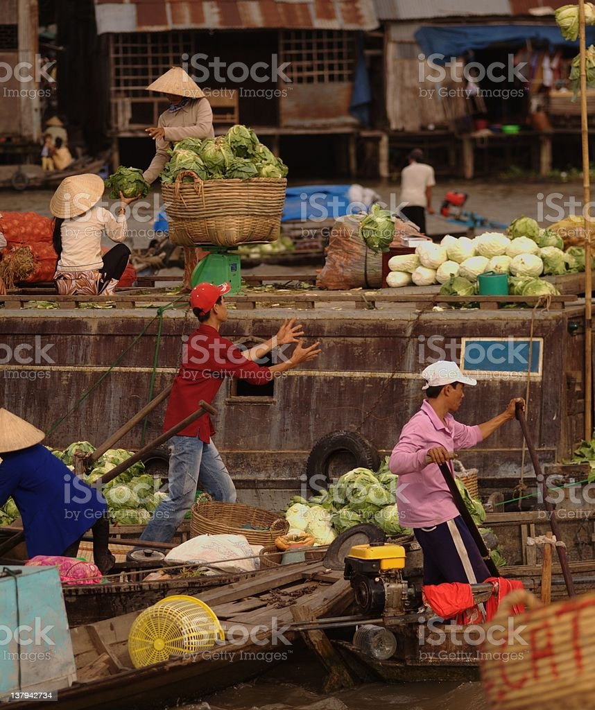 Busy floating market and flying cabbage royalty-free stock photo