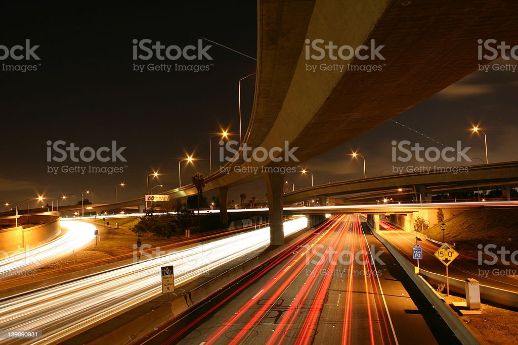 Busy freeway nightime traffic jet trails royalty-free stock photo