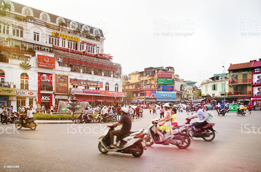 Busy Hanoi Fountain roundabout with traffic stock photo