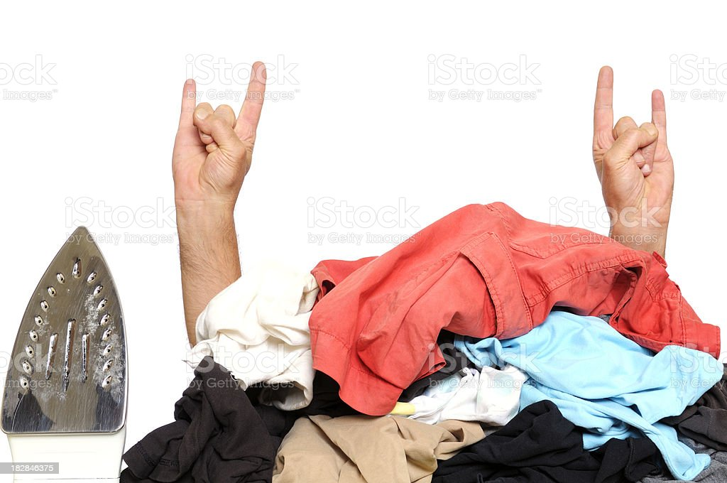 Busy House Husband Giving Rock Sign and Clothes to Iron royalty-free stock photo