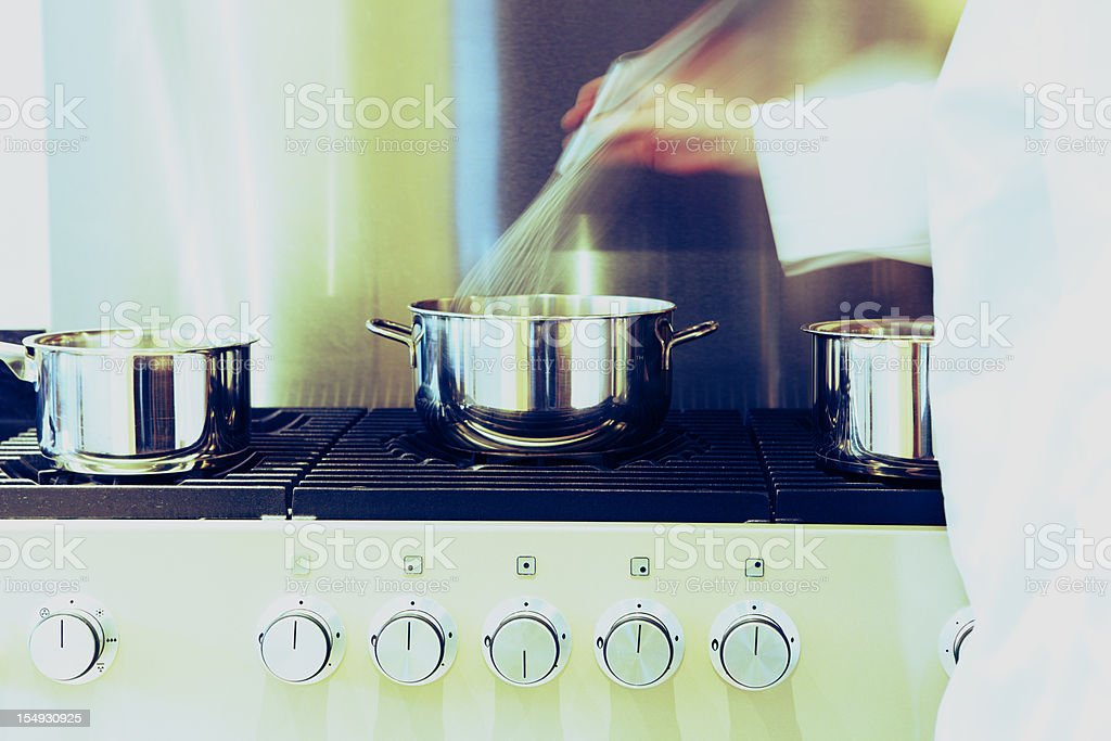 Busy Kitchen Stove with Pans royalty-free stock photo