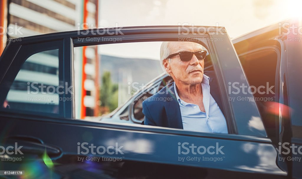 Busy man hailing a taxi stock photo