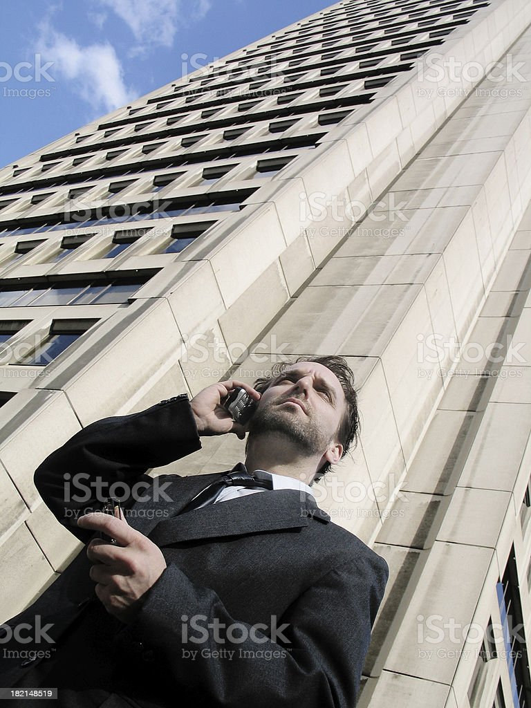 Busy man in front of an office royalty-free stock photo