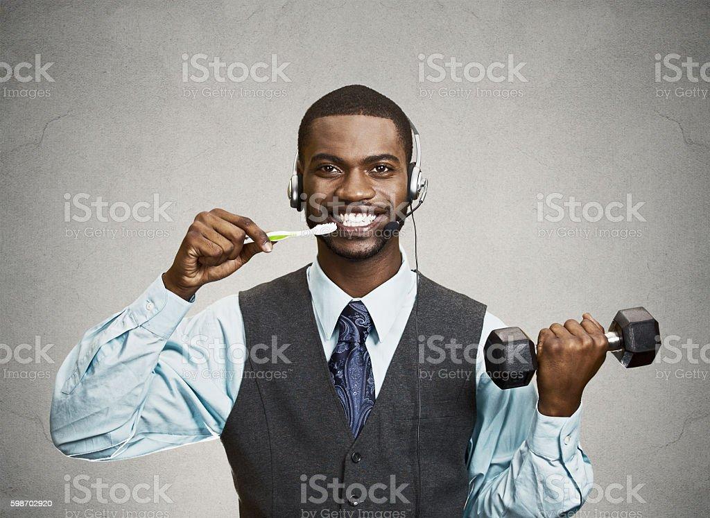 Busy man multitasking stock photo