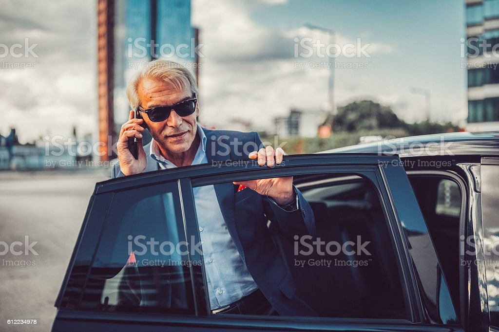 Busy man talking on phone stock photo