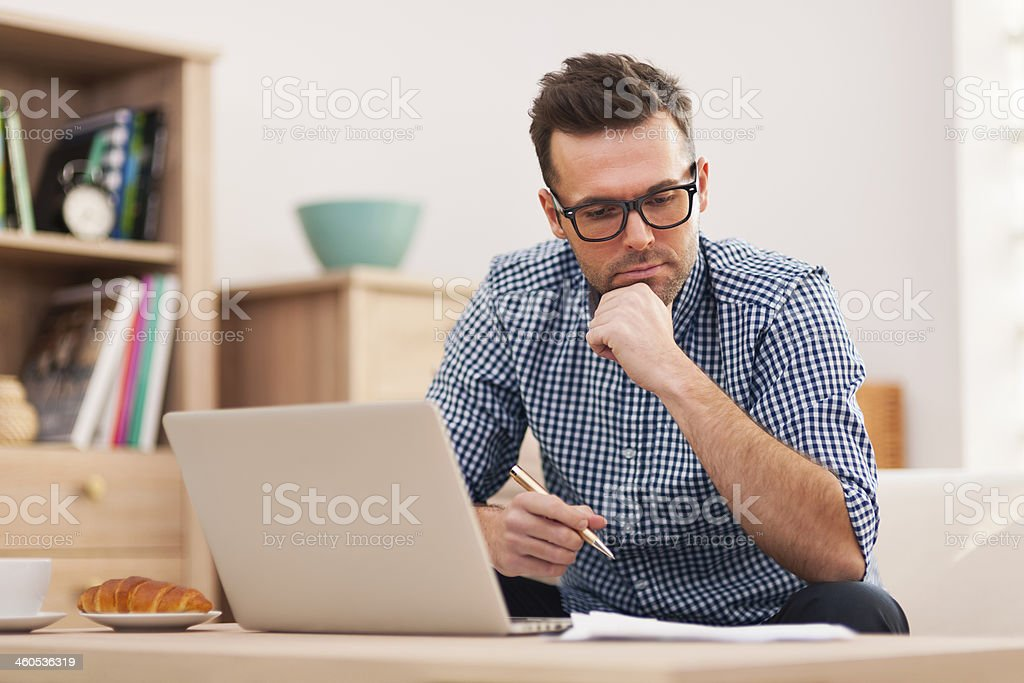 Busy man working at home stock photo
