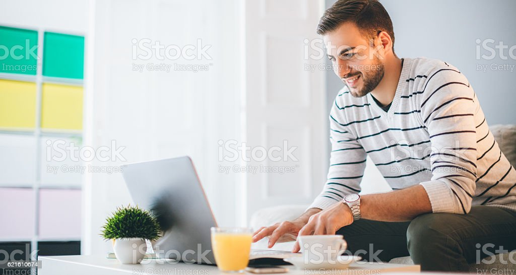 Busy man working from home stock photo