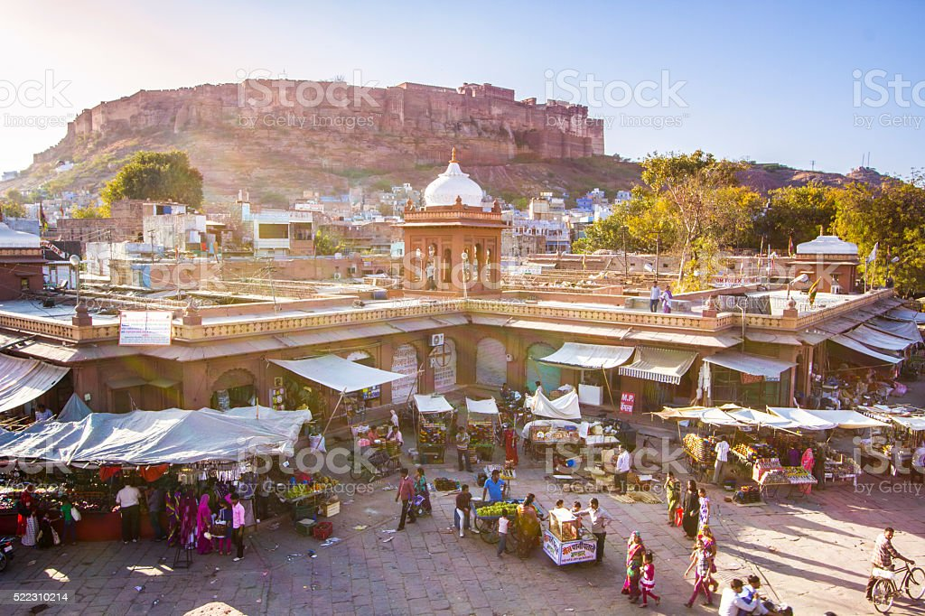 Busy market in Jodhpur with Mehrangarh Fort behind stock photo