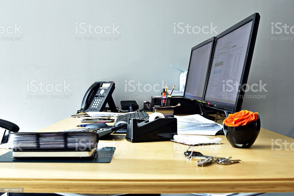 busy office desk with all items at the work stock photo