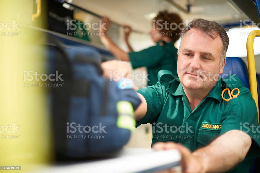 busy  paramedic in the ambulance stock photo